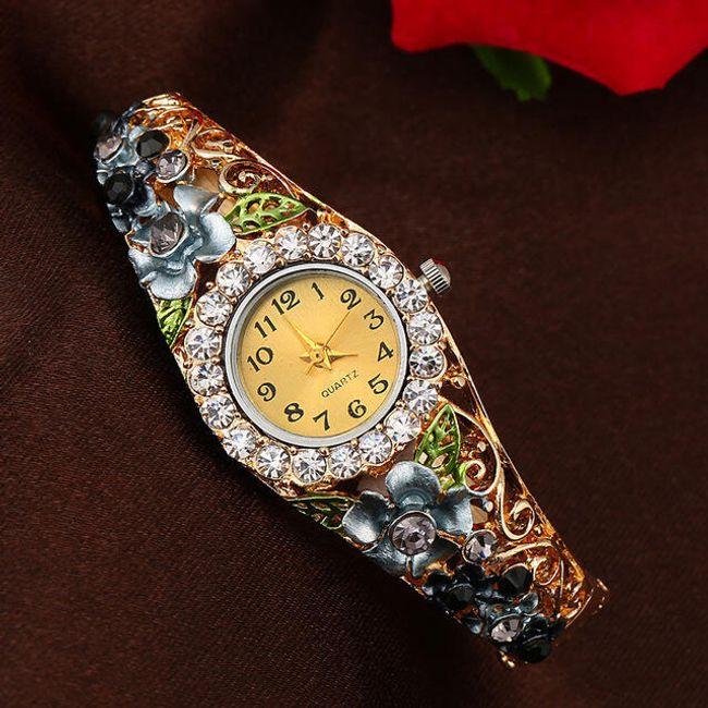 Ženska kovinska ura s paščkom okrašenim z rožicami - 6 barv 1
