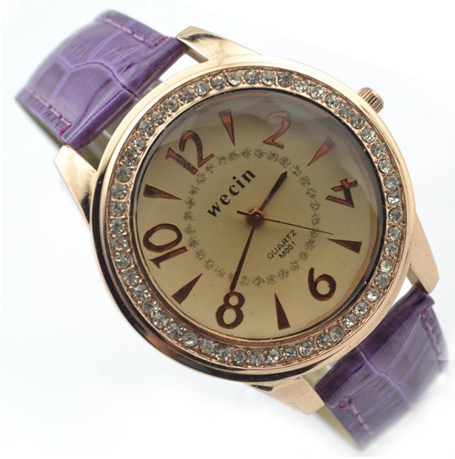 Modny damski zegarek z ozdobnymi kamykami  1