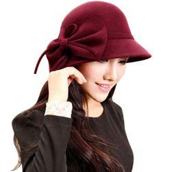 Jednokolorowy damski kapelusz z kokardą