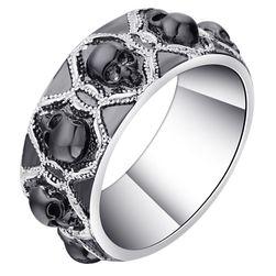 Pánský prsten s černými lebkami