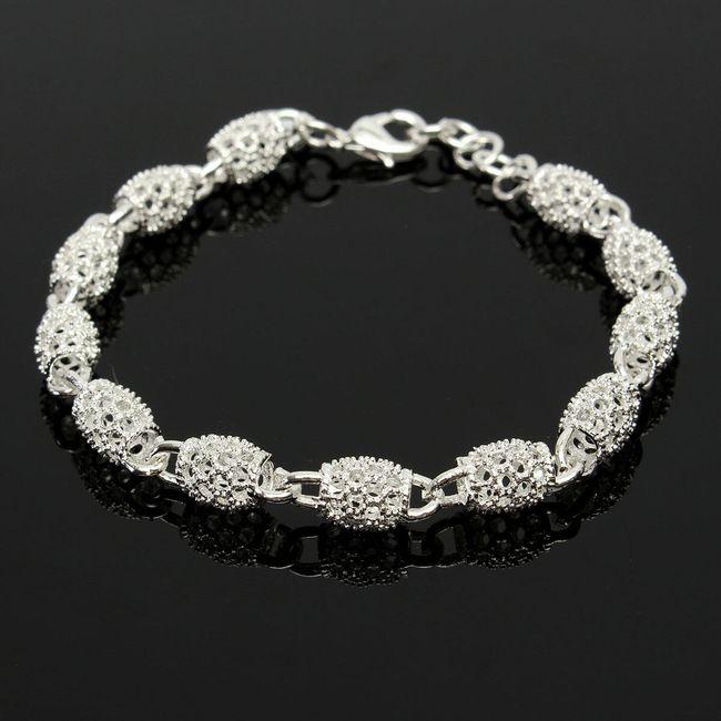 Женский богато украшенный браслет из серебра 1
