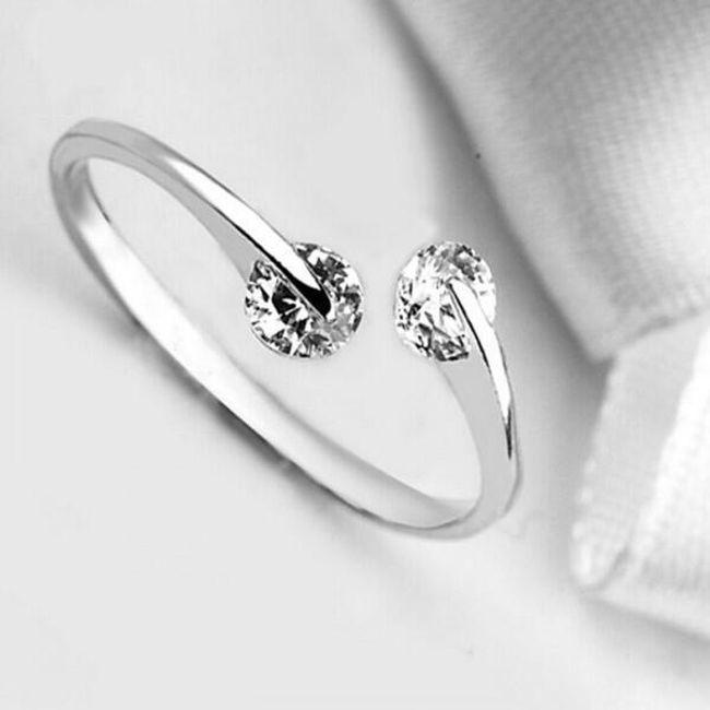 Ženski prstan z dvema prozornima kamnoma 1