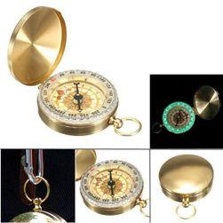 Kompas ve zlaté barvě s osvětlením