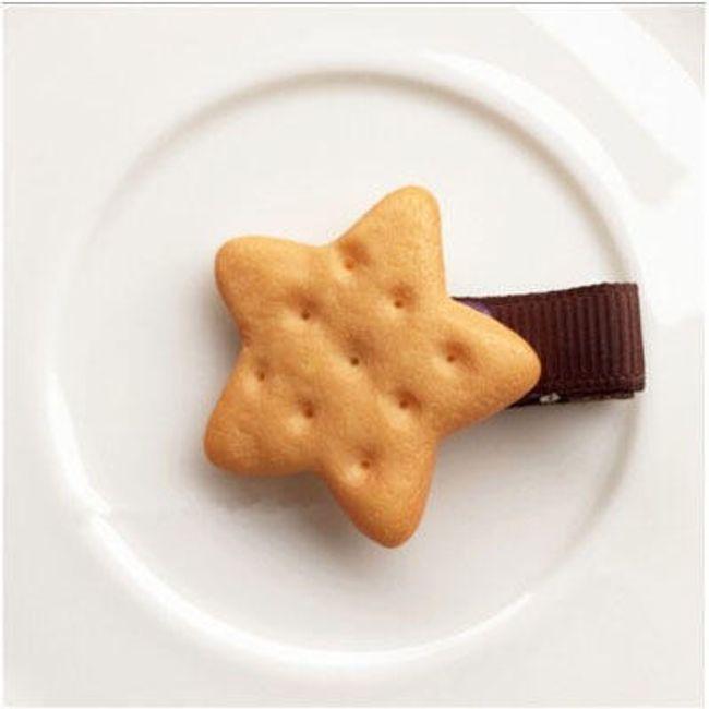 Sponka nebo gumička se sušenkou 1