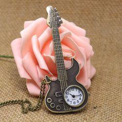 Джобен часовник във фирмата на китара