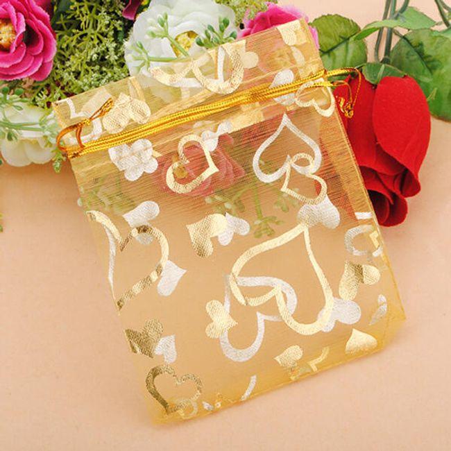 100 darab arany színű táska szívvel 1