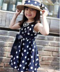 Otroška obleka s polka pikami in lokom