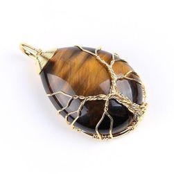 Egy energikus csepp alakú medál, kötve az élet fájával